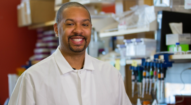 Michael Johnson, an assistant professor of immunobiology, worked with two doctoral students to bring National DNA Day to Tucson. (Photo: Mari Cleven/Office of Research, Discovery and Innovation)