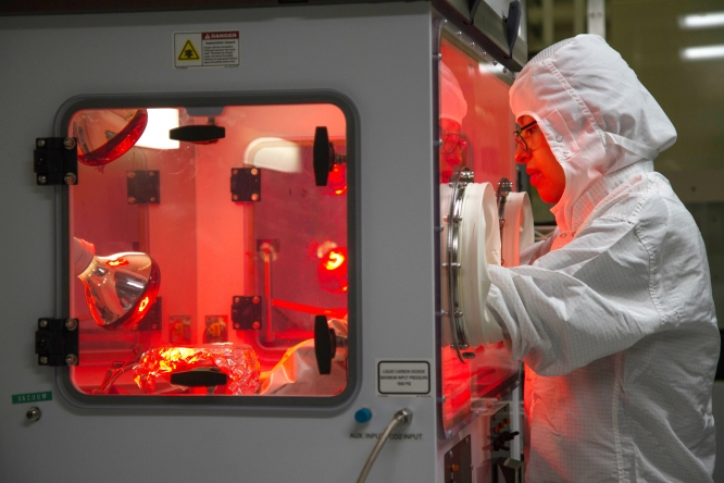 A staff member at work at the Micro/Nano Fabrication Center, one of many core facilities on the UA campus.