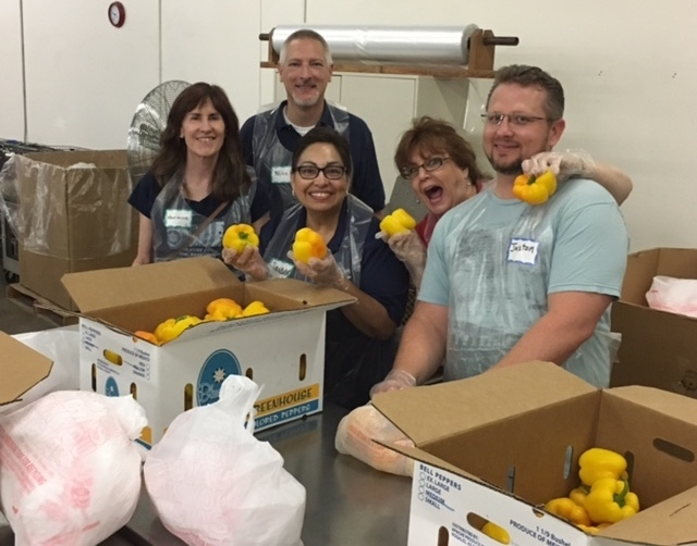 UA employees volunteering at the Community Food Bank of Southern Arizona.