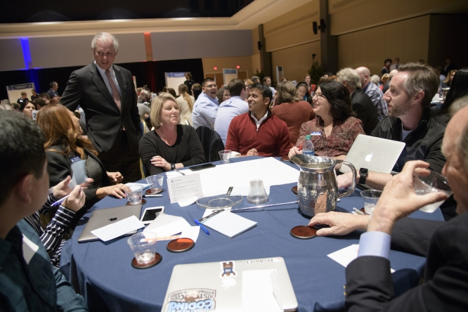 President Robert C. Robbins chats with a table of attendees. (Photo by Kris Hanning/AHS BioCommunications)