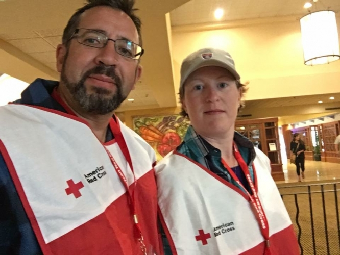 Andrea Kelly, assistant news director for Arizona Public Media, with her husband, Michel Marizco, during Red Cross volunteer training in Santa Rosa, California. The couple, who married just as fires began tearing across northern California in early October, ditched their honeymoon plans to volunteer at a shelter.