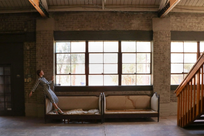 """Autumn Eckman (pictured), assistant professor in the School of Dance, Michelle Gott, assistant professor in the Fred Fox School of Music, and former MFA student Dorsey Kaufmann collaborated on """"Reframe,"""" which was shot in abandoned buildings in Tucson to evoke the experience of isolation."""