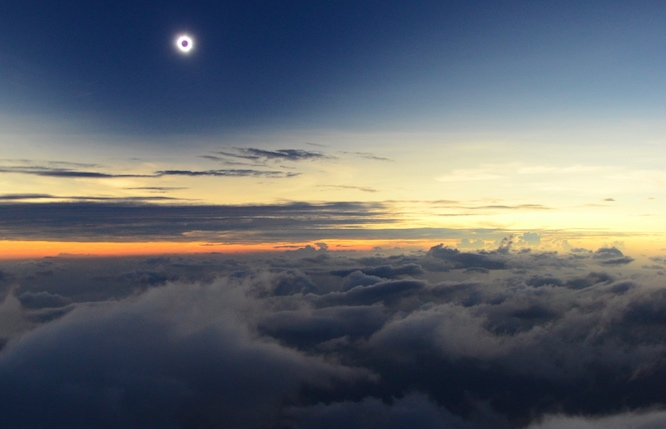 University of Arizona astronomer Glenn Schneider traveled to northern Kenya to see this total solar eclipse in 2013. Schneider and fellow eclipse chasers nearly missed it due to a dust storm, but they saw it from a plane 300 feet above the clouds. (Photo by Catalin Beldea, courtesy of Glenn Schneider)