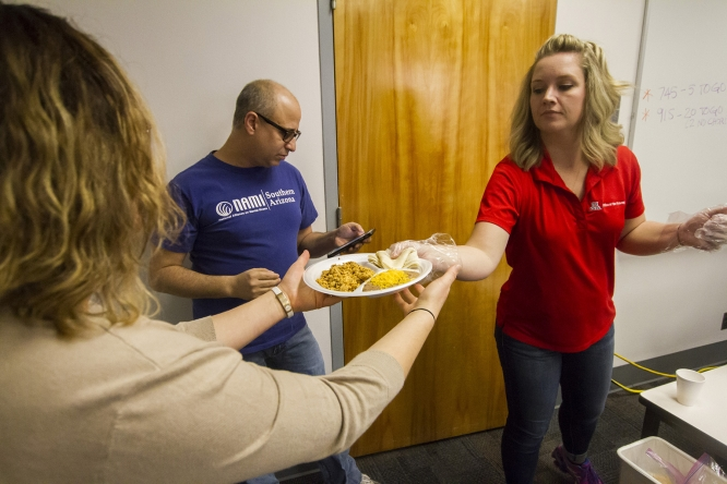 A volunteer passes a plate of chorizo and eggs during the Office of Budget and Planning's chorizo breakfast last year. The event will return for its 19th year on Oct. 26. (Photo: Kyle Mittan/University Communications)