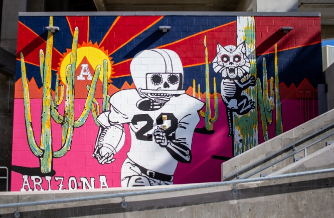 "Local artist Danny Martin's new mural at the southeast corner of Arizona Stadium, titled ""The Cactus Comet Rides Again,"" depicts legendary UA football player Art Luppino. (Photo: Kyle Mittan/University Communications)"