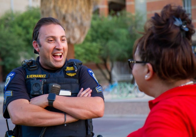 UAPD Sgt. Rene Hernandez chats with Nichole Guard, a senior program coordinator in the Department of Spanish and Portuguese, during a walk on the Mall. (Photo by Kyle Mittan/University Communications)