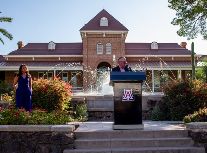 President Robert C. Robbins delivers remarks at the UA Cares campaign kickoff event. Karla Bernal Morales (left), interim director of the Office of Multicultural Advancement, is coordinating the campaign. (Photo: Kyle Mittan/University Communications)