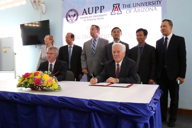 Brent White, seated at left, attends the signing of the agreement that created UA Phnom Penh at the American University of Phnom Penh in Cambodia. (Photo courtesy of the American University of Phnom Penh)