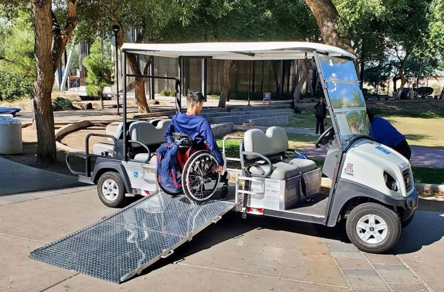 Student Michael Seo uses the disability cart service, which provides on-campus transportation for members of the campus community with a permanent or temporary impairment.
