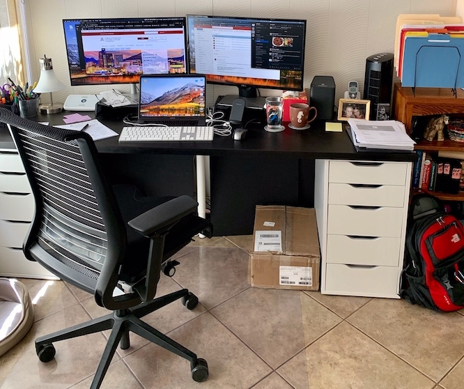Simmons Buntin, marketing and communications manager in the College of Architecture, Planning and Landscape Architecture, is borrowing his office chair during the work-from-home period. (Photo courtesy of Simmons Buntin)