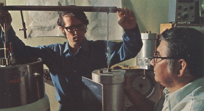 George Rieke, Regents Professor of astronomy and planetary sciences, transfers liquid helium in this 1973. To the right is his mentor, Frank Low, Regents Professor emeritus. (Photo courtesy of George Rieke)