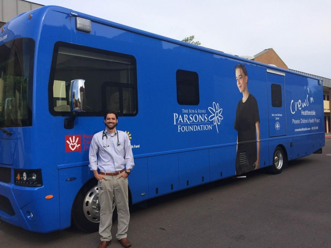 Gary Kirkilas stands in front of the mobile health unit he uses to reach homeless and disadvantaged communities.
