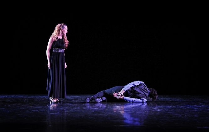 """UA assistant professor of dance Tammy Dyke-Compton stands over Chris Compton, her husband, during a performance titled """"Music of Regret."""" (Photo by Ed Flores, courtesy of Dyke-Compton)"""