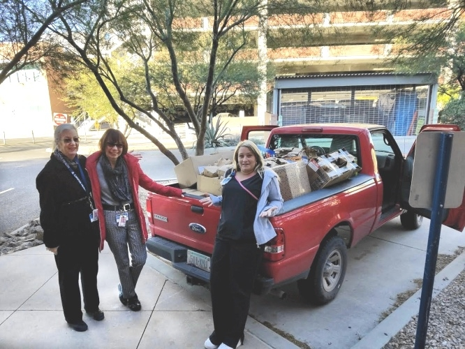 From left: Margaret Sifford, Monica Johns and Amy Jackson delivered brown-bag lunches to Casa Maria and donated additional time on Black Friday.