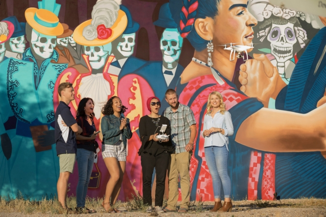Students in the School of Journalism have been learning to fly drones with the help of Michael McKisson (second from right), associate professor of practice. Others pictured, from left: journalism alumnus Erik Kolsrud, associate professor Celeste González de Bustamante, and journalism alumni Zeina Cabrera-Peterson, Dalal Radwan and Amanda Oien. (Photo by Chris Richards/Alumni Relations)