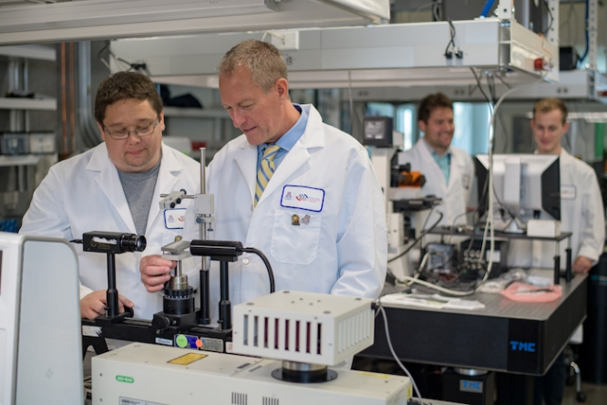 Frederic Zenhausern, right, professor and director of the Center for Applied NanoBioscience and Medicine, works in his lab with Matthew Barrett, a senior research specialist. (Photo courtesy of the College of Medicine – Phoenix)