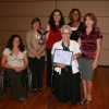 Sue Kroeger, director of the Disability Resource Center (holding plaque) was honored with a 2008 Vision Award by the UA Commission on the Status of Women. She is shown here with (left to right) Amanda Kraus, Linda Breci, Christine Salvesen, Lynette Cook-Francis and Laura Todd Johnson. (Photo by Ernie Webster)