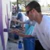 Volunteers painted a mural on the playground walls at Project YES  during last year's Cats in the Community Day.