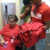Juliette Moore, who was among those to found Wildcat Welcome 10 years ago, helps sort through T-shirts.