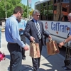 """President Robert N. Shelton helps """"Stuff the Cat Tran"""" at an inaugural food drive hosted by the Staff Advisory Council and Parking and Transportation Services this spring."""