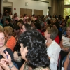 Employees packed a room in the library during a town hall with President Robert N. Shelton.