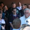 Peter Smith, with members of the Phoenix team behind him, talks to the media outside the Science Operations Center.