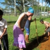 Josephine Corder (second from left) helps dig a drainage trench with students and colleagues at Pohnpei Catholic School in Micronesia in 2010. (Photo courtesy of Josephine Corder)