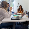 Student interns in the UA design lab discuss their work. From left: Ana Garcia, Ali Alshabeeb, Vanessa Ojeda, Maria Manaog and Caitlin Hooker. (Photo: Kyle Mittan/University Communications)